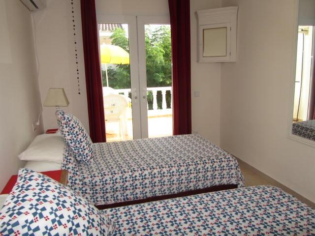 2 single beds/double as required.Fitted wardrobes,Aircon.Balcony