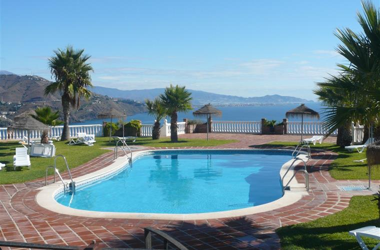 Sunny swimming pool all day with superb sea views