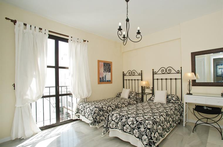 Guest Bedroom with twin beds and Juliette Balcony.