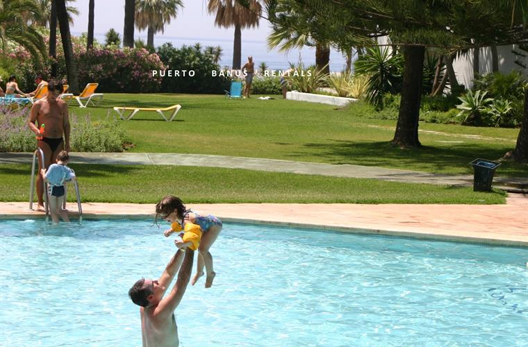 Family fun in the pool with Meditteranean sea in the background