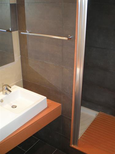 Modern bathroom with glass enclosed showers