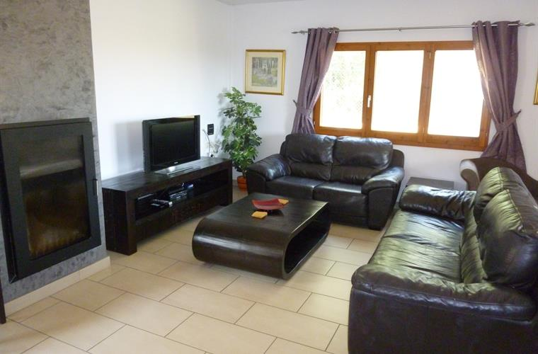 Comfortable seating in the lounge with satellite TV and DVD player