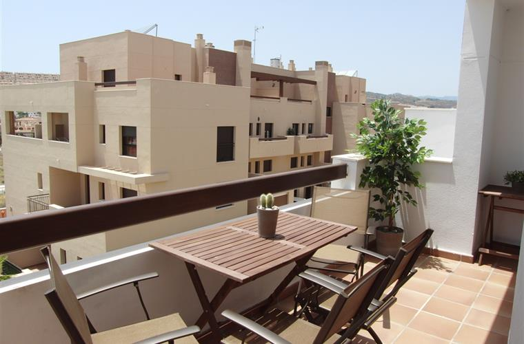 Nice SW facing terrace with also lovely mountain views
