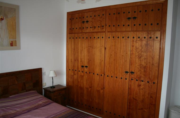 wardrobe with safe in main bedroom with double bed