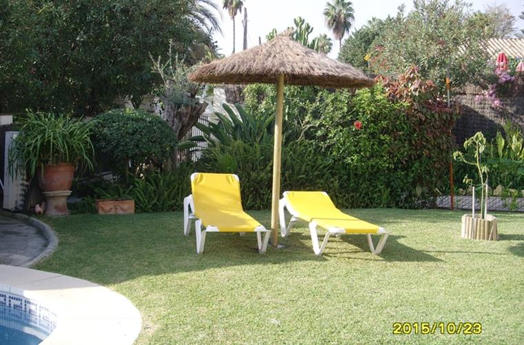 thatched parasol, for some extra shade at the poolside