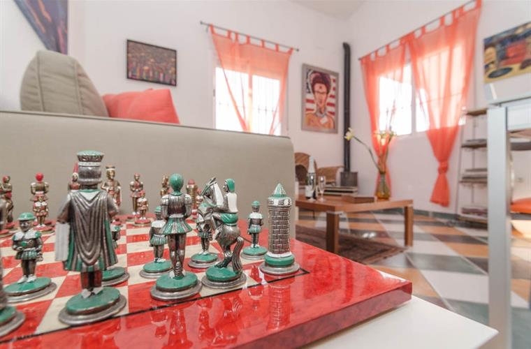 Main room view with chess game