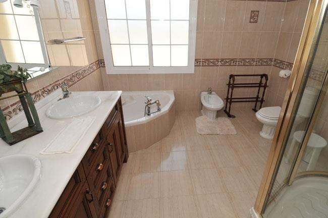 Master en-suite bathroom with bath tube and separate shower cabin