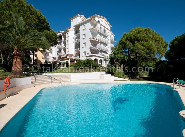 Poolside holiday apartments in Puerto Banus Spain