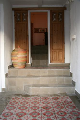 the hallway and stairs towards the living.