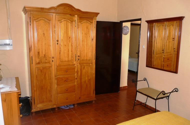 Beautiful wooden wardrobe in the double bedroom