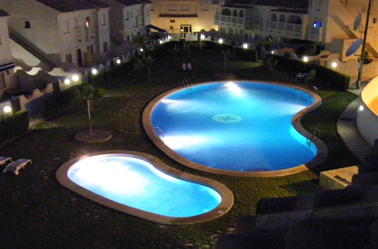 The swimming pools at night. Taken  from the rooftop solarium