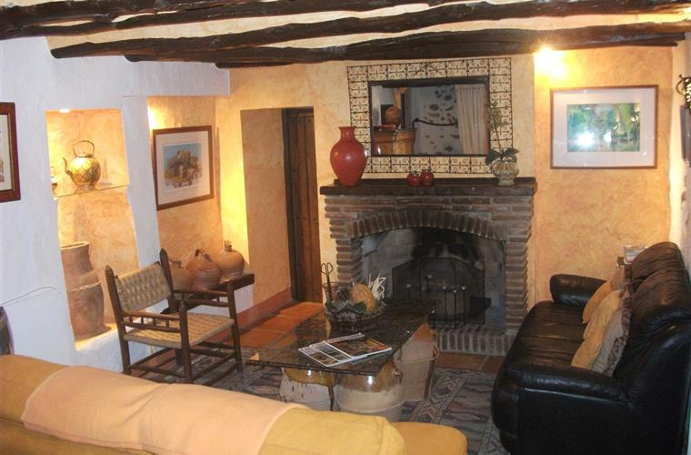 cosy living room with open fire place heating in winter provided.