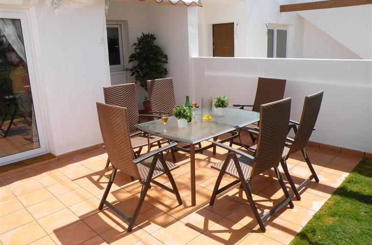 Front terrace area with 6 table and chairs and retractable awning