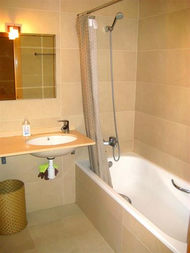 High Quality Bathroom with shower and full size bath.