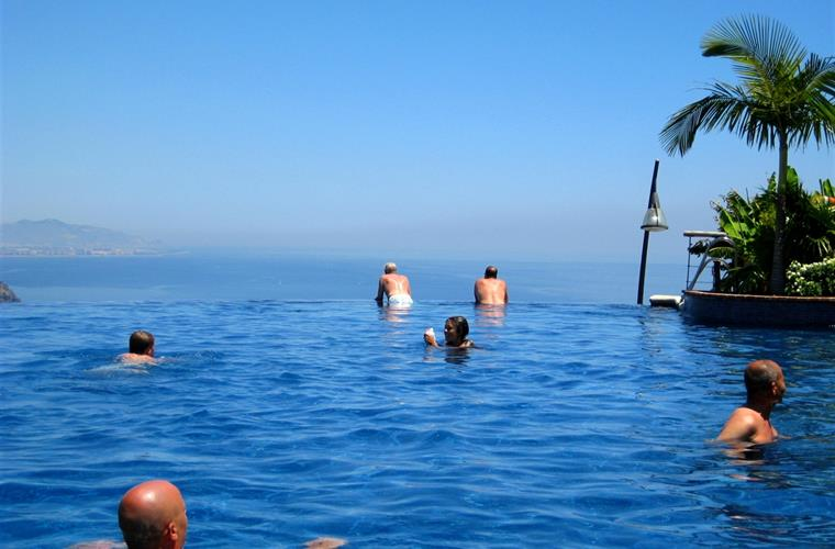 Infinity swimming pool with fantastic sea and mountain views.