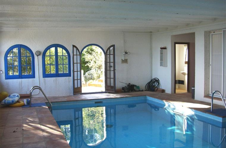indoor pool with  access to garden and terrace