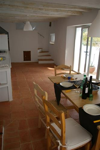 Dining room and kitchen with doors to the courtyard