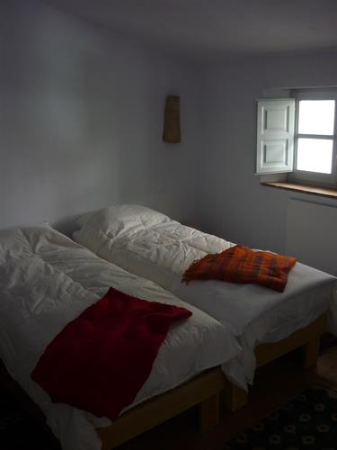 Upstairs bedroom has two single beds