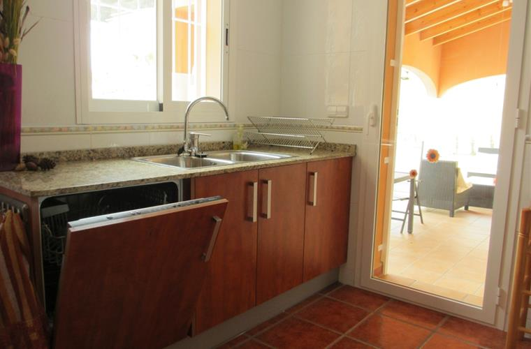 Very complete kitchen with entrance to the patio, garden and pool