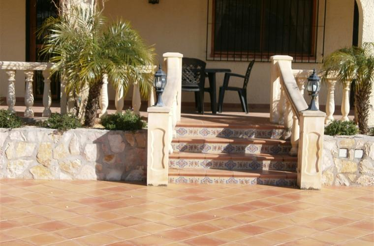 STEPS FROM THE TERRACE TO POOL AREA