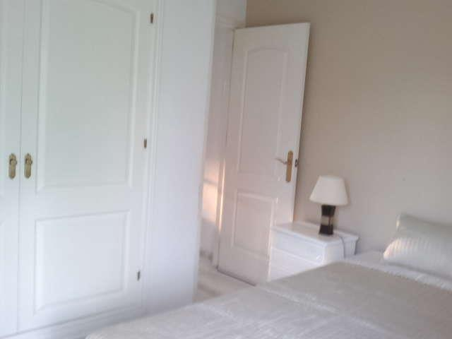 Double bedroom 2 beds and wardrobe