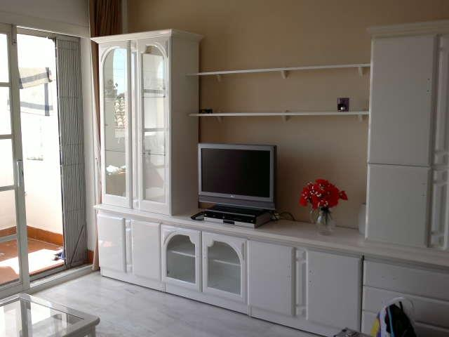 Livingroom with acces to terrace. TV with DVD.