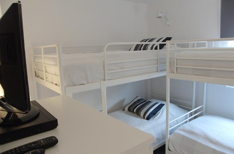 The 3rd bedroom with two bunkbeds á 90 cm and a extra bed