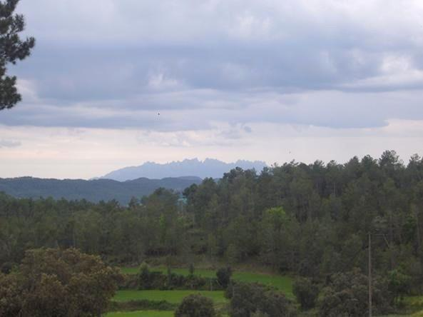 "The mountain range ""Montserrat"" is seen in the background"