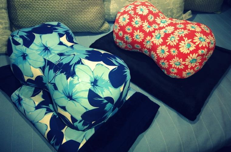 Vintage pillows, towels and ladies bags.
