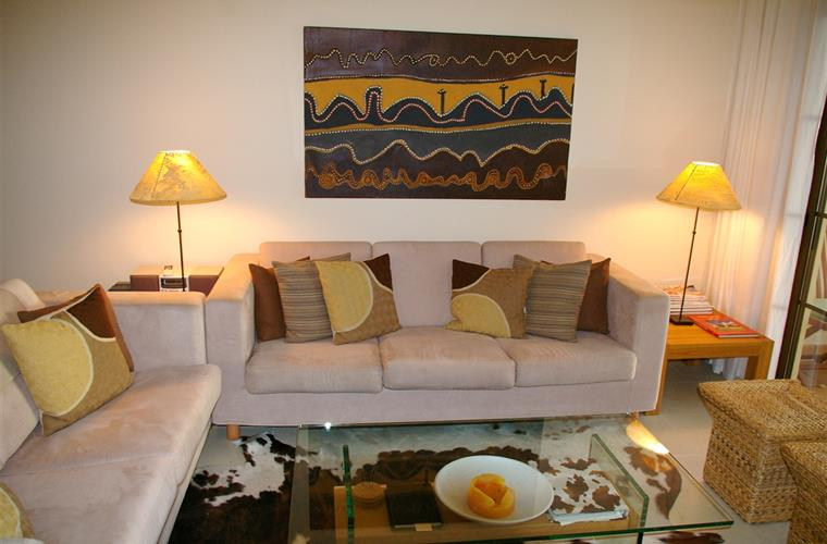 Stylish comfortable lounge with original art works & mood lighting
