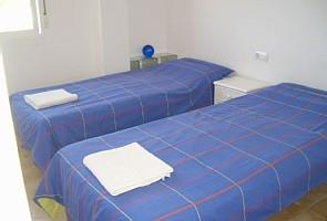 3rd Bedroom with 2 Single Beds, Cane Furniture, Mirror, Wardrobes,