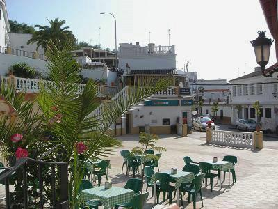 The town Plaza with bars and restaurants