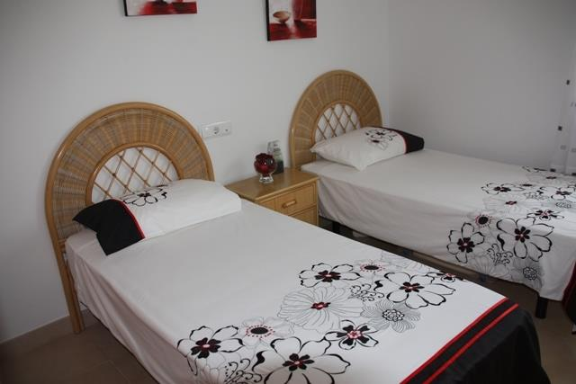 The second bedroom with two single beds
