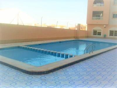 The communal swimming pool is open during the summer months.