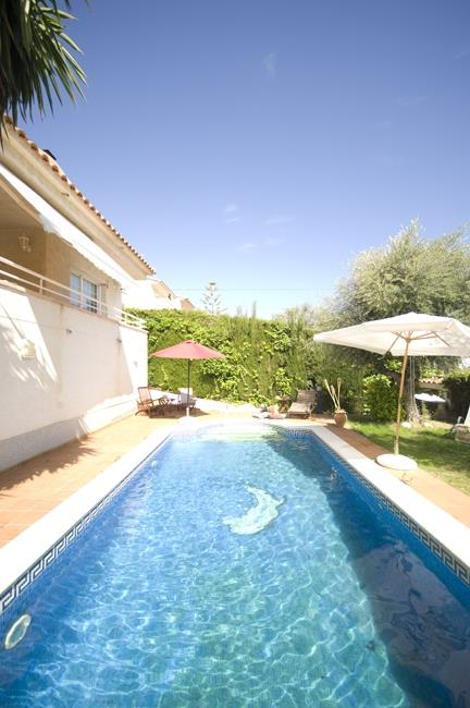 View of private swimming pool and villa