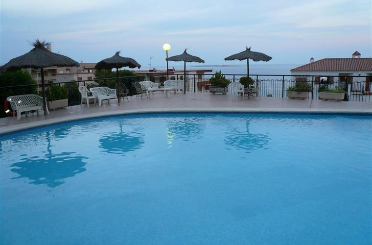SWIMNING POOL WITH SEA VIEWS AT EVENING