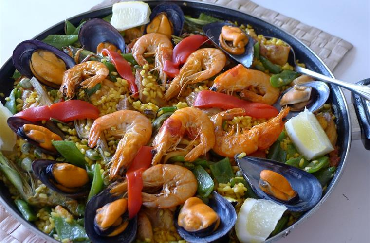 Enjoy a paella cooking class.