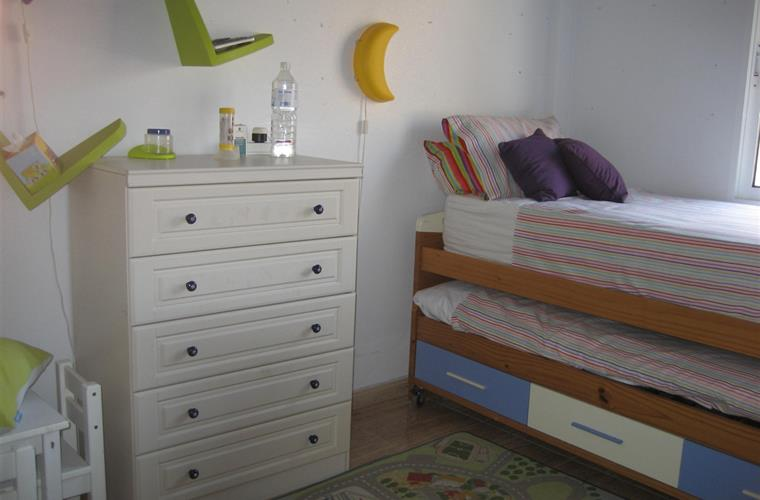 Child friendly room with high-rise bed and pull-out bed.