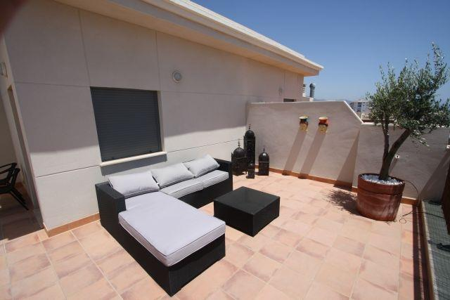 Terrace with sofa, sunbed, tabel and chairs