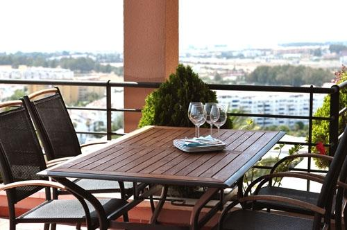 The dining table at the terrace with its view over the Sea