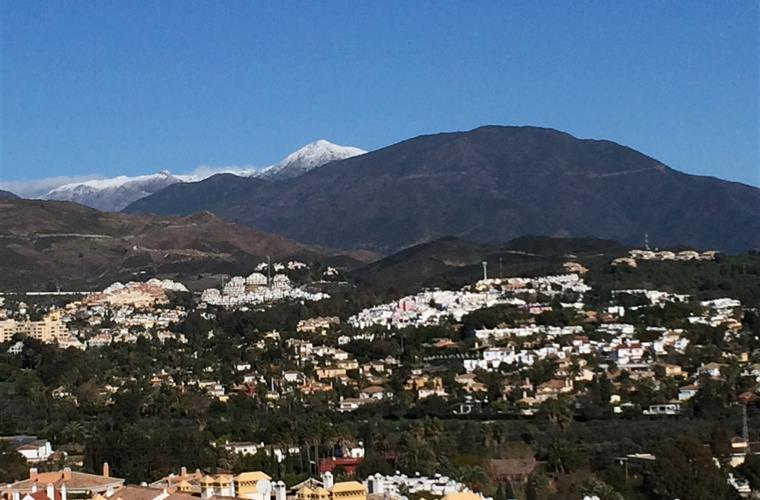 A look up to the mountains from the terrace with snow