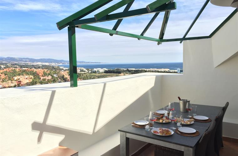 Terrace from lounge area with a beautiful view over Marbella