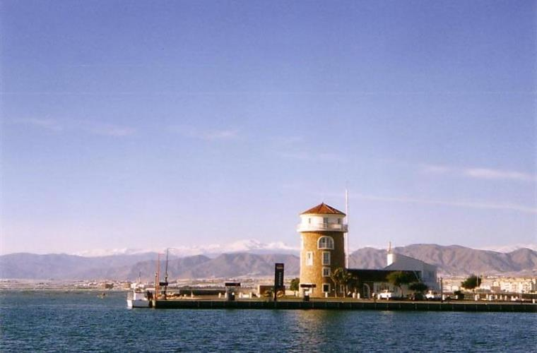 The harbour tower at the entrance of the marina of Almerimar.