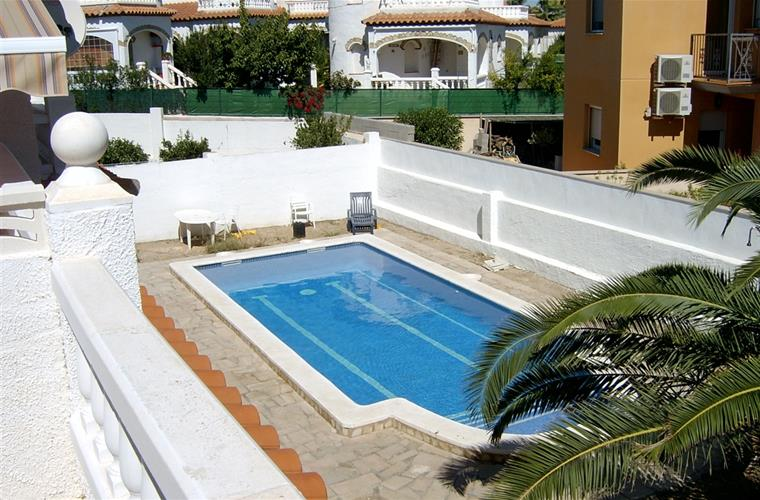 SIDE VIEW OF THE SWIMMING POOL