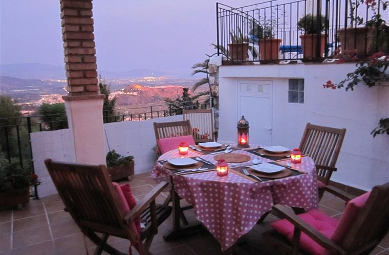 Eating dinner at night, with the view of the Moorish castle lit up