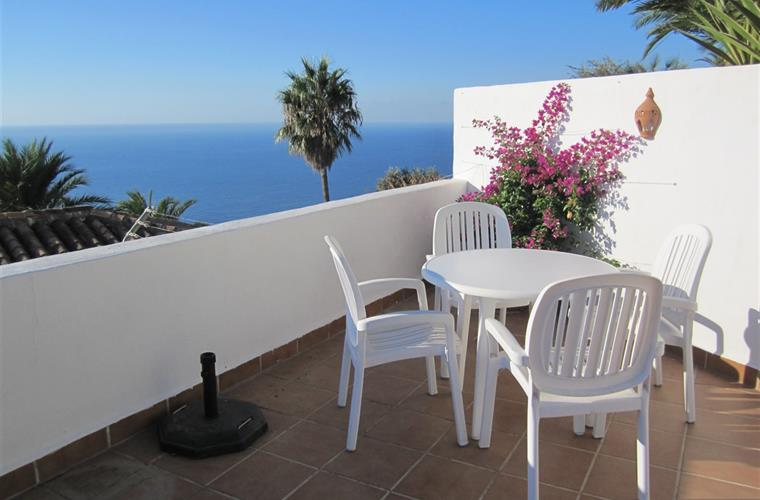 We like to have breakfast on the top terrace overlooking the sea