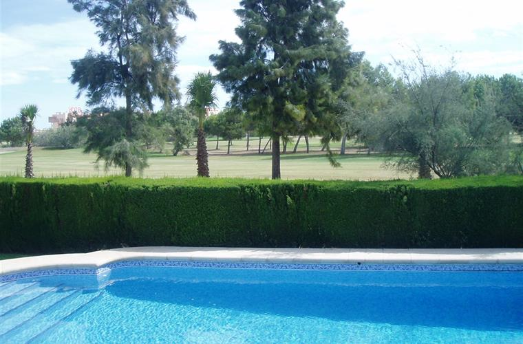 Pool with views across Oliva Nova Golf course