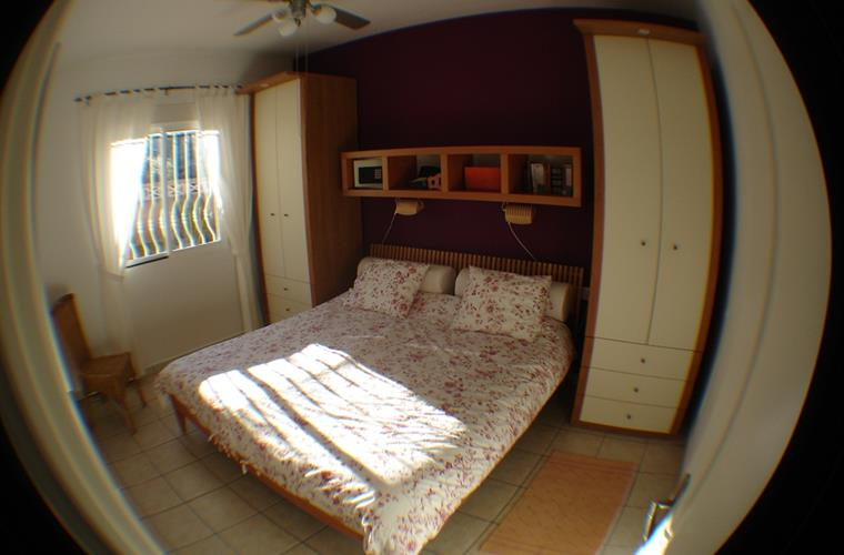 Spacious and sunny bedroom with double bed.