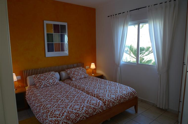 Spacious and comfortable bedroom with sea views.