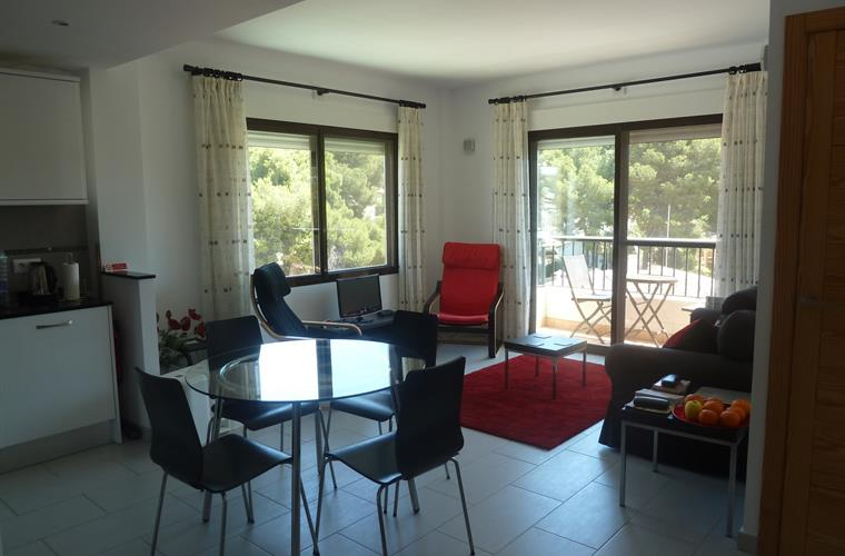 Dining area and dual aspect lounge with patio doors to balcony.